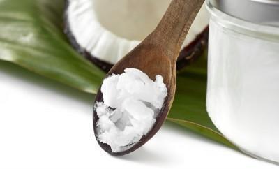 Coconut oil in a wooden spoon