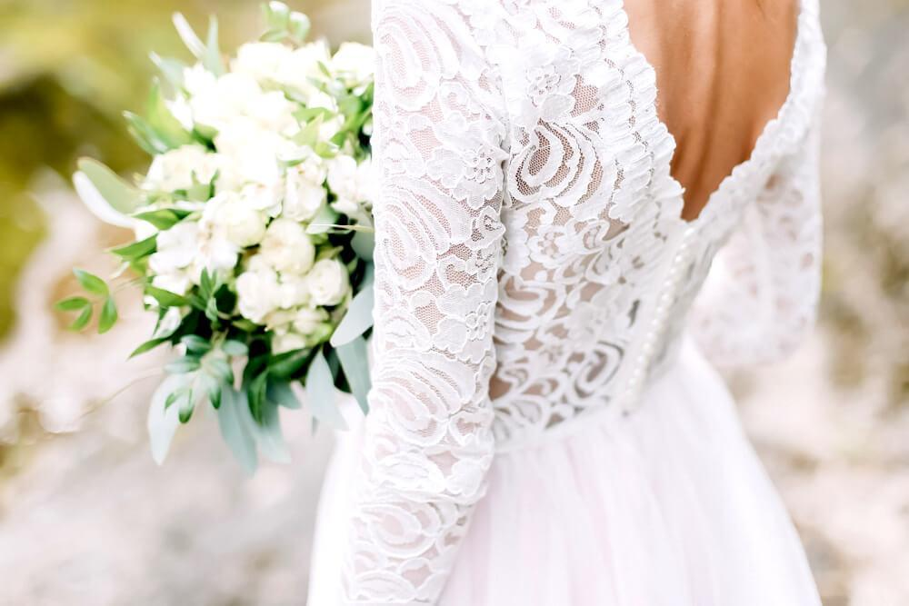 Back view of bride's lace wedding dress